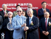 Jason Yeung Chi Wai, Deputy Chief Executive, Bank of China (Hong Kong) Limited, presents a crystal trophy to winning trainer John Moore.