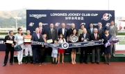 HKJC Chairman Dr Simon Ip (back row, 1st from right); HKJC Stewards; Chief Executive Officer Winfried Engelbrecht-Bresges (back row, 1st from left); Karen Au Yeung, Vice President of LONGINES HK and connections of LONGINES Jockey Club Cup winner Blazing Speed  pose for a group photo at the presentation ceremony.