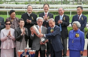 At the presentation ceremony, Dr Y C Chow, Chairman of Chevalier International Holdings Limited, presents the Chevalier Cup trophy to All You Wish��s owner Chan Fut Yan and Carmen Chan Wing Yee.