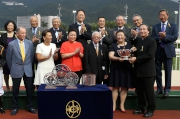 Photo 5, 6, 7<br> Mr Stephen Ip Shu Kwan (front row, first from right), a Steward of the Hong Kong Jockey Club, presents the Premier Bowl Trophy and silver dishes to Dr & Mrs Cornel Li Fook Kwan, owner of Able Friend, trainer John Moore and jockey Karis Teetan.