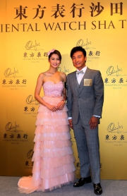 Artistes Alex Fong and Eliza Sam attend the ��Gentlemen��s Bow-tie Day��.